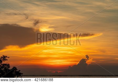 Beautiful Sunset Sky Over The Tropical Sea. Golden Sunset Sky. Skyline At The Sea. Beauty In Nature.