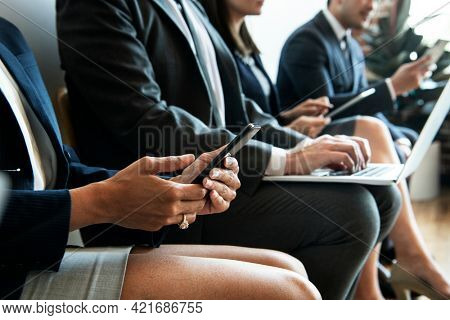 Business people using digital device