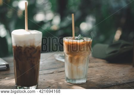Selective Focuson Iced Latte Coffee And Iced Mocha On Wooden Table. Summer Cold Refreshing Drink Con