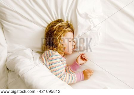 Cute Little Toddler Girl Sleeping In Big Bed Of Parents. Adorable Baby Child Dreaming In Hotel Bed O