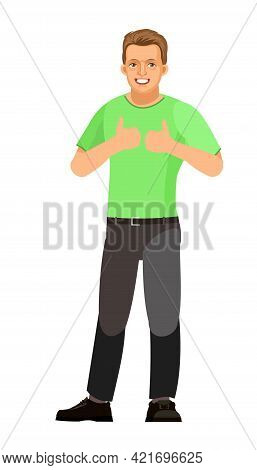 The Guy Is Standing. Young Handsome Handsome Boy. A Friendly Smile. In Jeans And A T-shirt. Rejoices