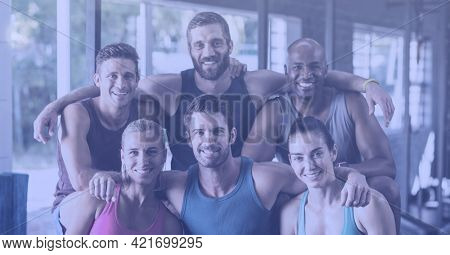 Composition of smiling men and women embracing in fitness class. sport, fitness and active lifestyle concept digitally generated image.