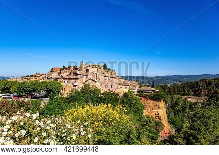 The village of Roussillon is surrounded by picturesque ocher cliffs. Bizarre ocher rocks, where the pigment quarry used to be. France, Provence