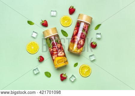 Strawberry Infused Water, Cocktail, Lemonade Or Tea. Summer Iced Cold Drink With Strawberry, Lemon A