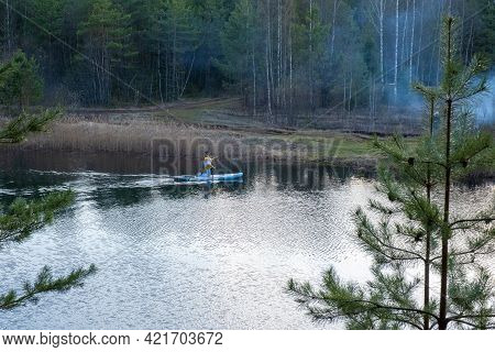 Ivanovo Region, Russia-01.05.2021: A Woman Kneeling On A Boat On A Small Forest Lake, Ivanovo Region