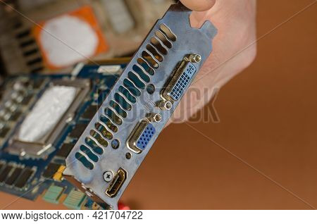 Computer Repair Services And Components Concept. A Man Is Holding A Disassembled Computer Graphics C
