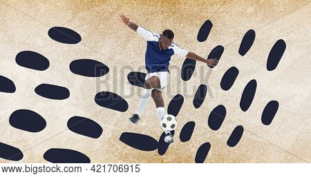 Composition of football player with ball over grey spots on concrete surface. sports event and competition concept digitally generated image.