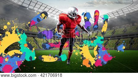 Composition of american football player over colourful handprints and sports stadium background. sports event and competition concept digitally generated image.