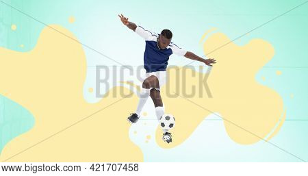 Composition of football player over yellow splodges and green background. sports event and competition concept digitally generated image.