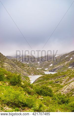 Lakes In Stone Rocky Mountains, Overcast Weather. Norway Summer Landscape. Norwegian National Touris