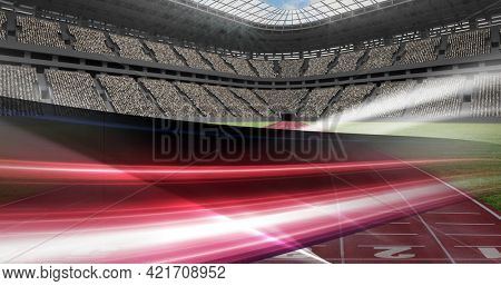 Composition of sports stadium with red and white light trails. sports event and competition concept digitally generated image.