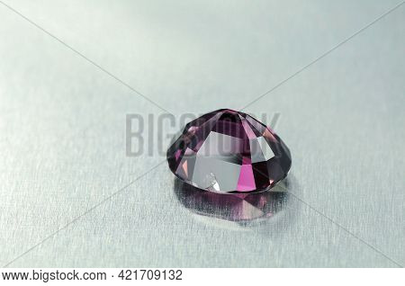Natural Faceted Purple Spinel Semiprecious Gemstone Upside Down Culet. Chip On Facet. Close Up Detai