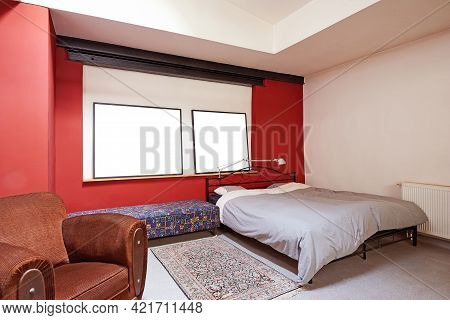 Vintage Bedroom With Two Frames On Wall