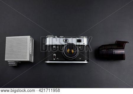 Photographic Set, Old Vintage Camera, Flash, Camera Roll On A Black Background.