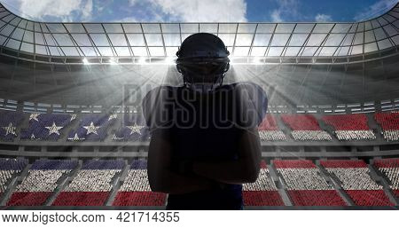 Composition of portrait of american football player on sports stadium with american flag. sport and competition concept digitally generated image.