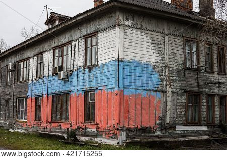 Khabarovsk, Russia-may 26, 2021: Old Residential Barracks Painted In The Color Of The Flag Of The Ru
