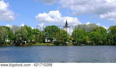Berlin, Germany, May 20, 2021, View From Treptower Park Over The River Spree To The Village Church A
