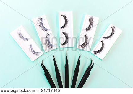 Different Tools For Eye Lash Extension On Trendy Pastel Mint Blue Background. Fake Eyelashes And Twe