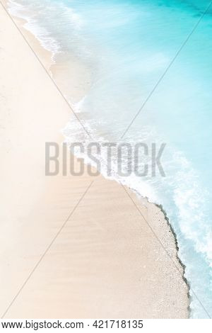 Tropical Beach With A Bird's Eye View Of The Waves Breaking On The Tropical Golden Sandy Beach. Sea