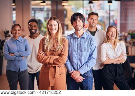Portrait Of Multi-Cultural Business Team In Modern Multi-Cultural Office