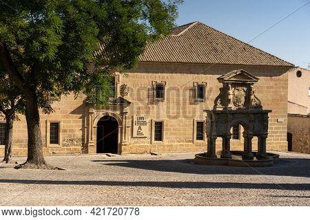 Baeza, Spain - September 07, 2020: University Facade And The Santa Maria Font In The Santa Maria Squ