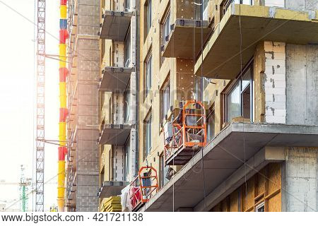 Suspended Construction Craddle Near Wall Of Hightower Residentaial Building With Glass Metal Modern