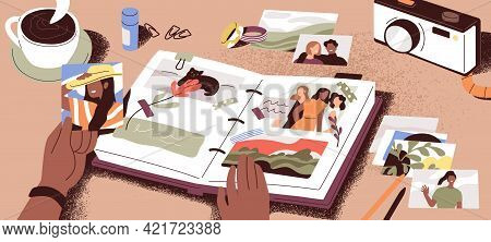 Female Hands Creating Photo Album, Attaching And Arranging Photographs And Memory Notes. Creation Of