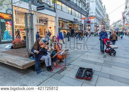 Vienna, Austria - 6 April 2015 - Female Street Musicians Perform For Passersby To Enjoy In Exchange