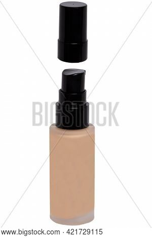 Cosmetic Foundation Isolated. Close-up Of An Open Glass Bottle With Liquid Skin Foundation Isolated