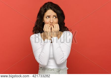 Anxious Stressed Woman Worried Of Mistake At Work, Bite Finger Nails In Confusion And Anxiety. Stres