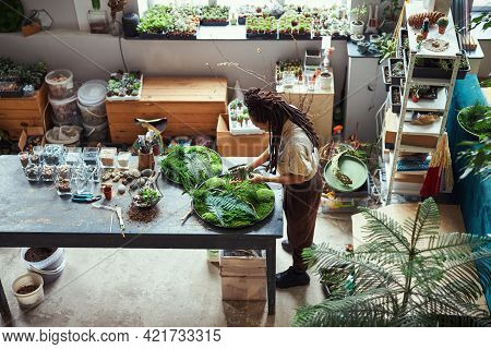 Experienced Florist Creating A New Circle Plant Panel