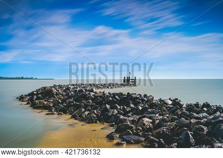 Stretch Dam With Basalt Blocks From An Old Fishing Harbor In The Dutch Lake 'ijsselmeer'
