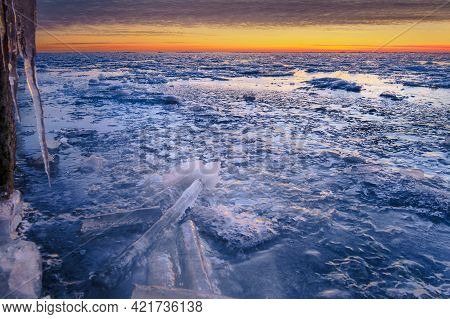 Beautiful Sunset Colors On The Sky And Clouds. Ice Patterns And Texture. Frosty Winter Time.