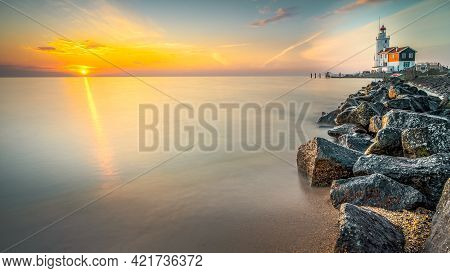 The Horse Of Marken Lighthouse (het Paard Van Marken) During Sunrise. Marken Is A Small Fishing Vill