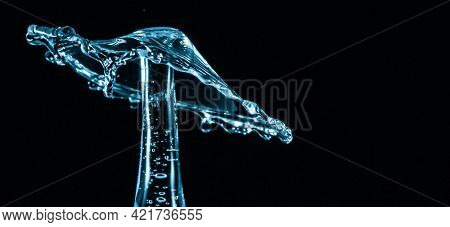 Water splash crown. Drop collision on black background