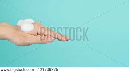 Hands Washing Gesture With Foaming Hand Soap On Green Mint And Tiffany Blue Background.