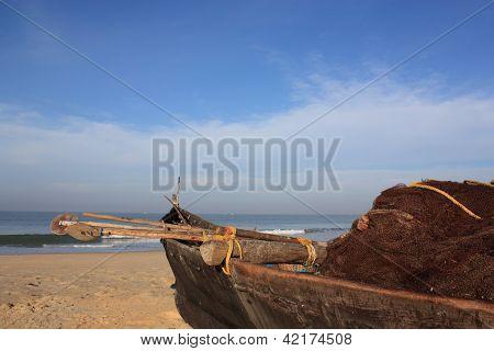 Fishing boat on Goa beach, India.