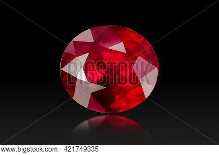 Natural Treated Red Ruby Oval Faceted Precious Gemstone Setting Isolated On Black Background. Front