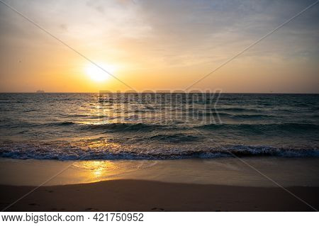 Sunrise In Ocean Or Sea At Miami Beach With Silhouette Of Ship On Sunset Sky Background, Sunset.