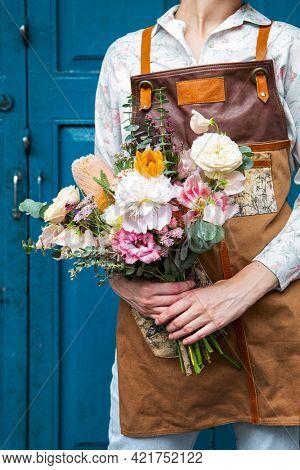 Florist holding a bouquet of flowers