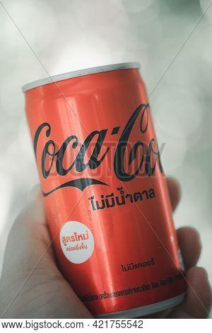 Bangkok, Thailand - May 26, 2021 : Hand Holding  New Formula Of Mini Can, Coca-cola No Sugar, Produc