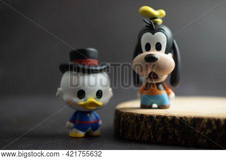 Samut Prakan, Thailand - May 26, 2021 : Cute Figurine Goofy And Scrooge Mcduck, Collection Figurine
