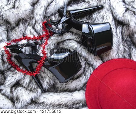 Flat Lay Female Black High-heeled Shoes And Red Accessories Collage On Wolf Fur Background. Female S