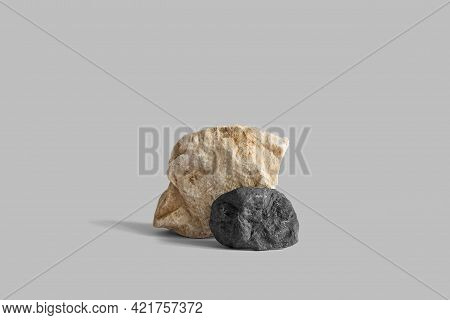 Beige And Black Marble Rock Pedestals On Gray Background With Copy Space, Side View. Podium Mockup F