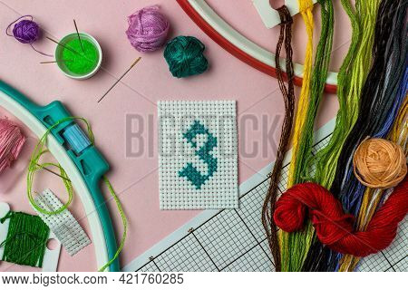 Green Number 3 Cross-stitch Embroidered Surrounded By Accessories For Embroidery: Threads Of Moulin