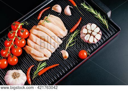 Chicken Fillet With Spices On Dark Wooden Kitchen Table. Top View With Copy Space.chicken Fillet On
