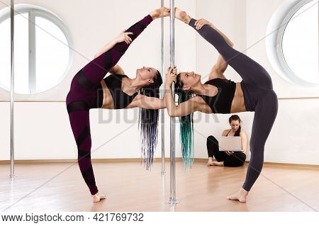 Pole Acrobatics Exercise For Fitness In Gym Of Training Studio.