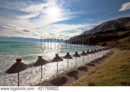 Idyllic Beach In Baska Sun Shades View, Island Of Krk, Croatia. Baska Is Famous Tourist Destination