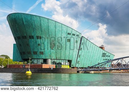 Amsterdam, Netherlands - 7th July 2014: The Nemo Science Museum on the waterfront and located in the Oosterdokseiland neighbourhood. Designed by Renzo Piano and opened in 1997.