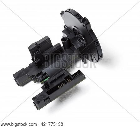 Steering Angle Sensor Disassembled On A White Isolated Background, Spare Part For Car Repair Or For